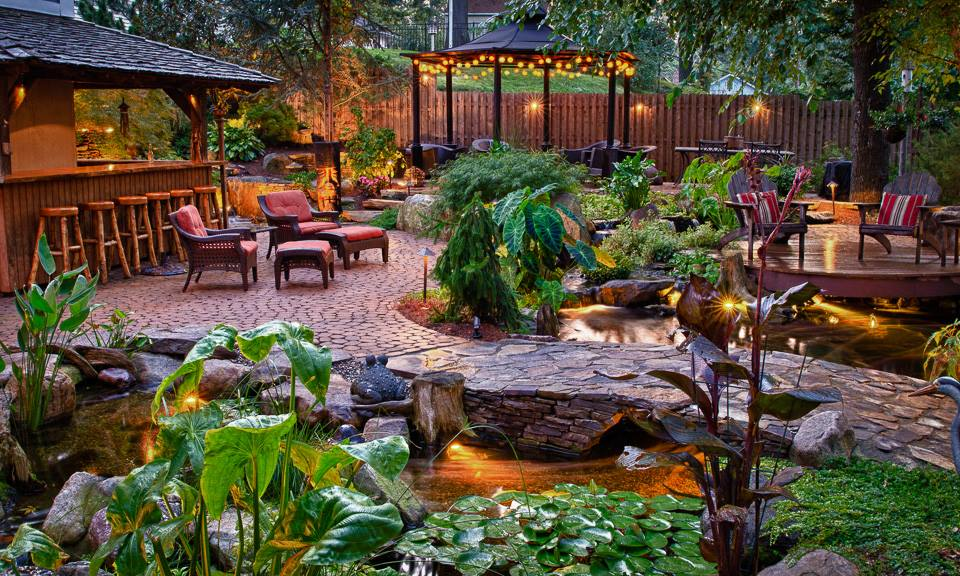 Using landscape garden bridges to enhance your backyard for Outdoor tropical fish pond